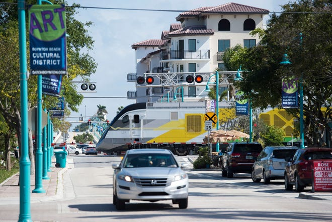 A Brightline train traveling north crosses East Ocean Avenue and Northeast Fourth Street in Boynton Beach. In January, Jeffrey D. King, 51, of Boynton Beach, was killed by a train when he pedaled around the gates, the second fatality by a Brightline train in a week.