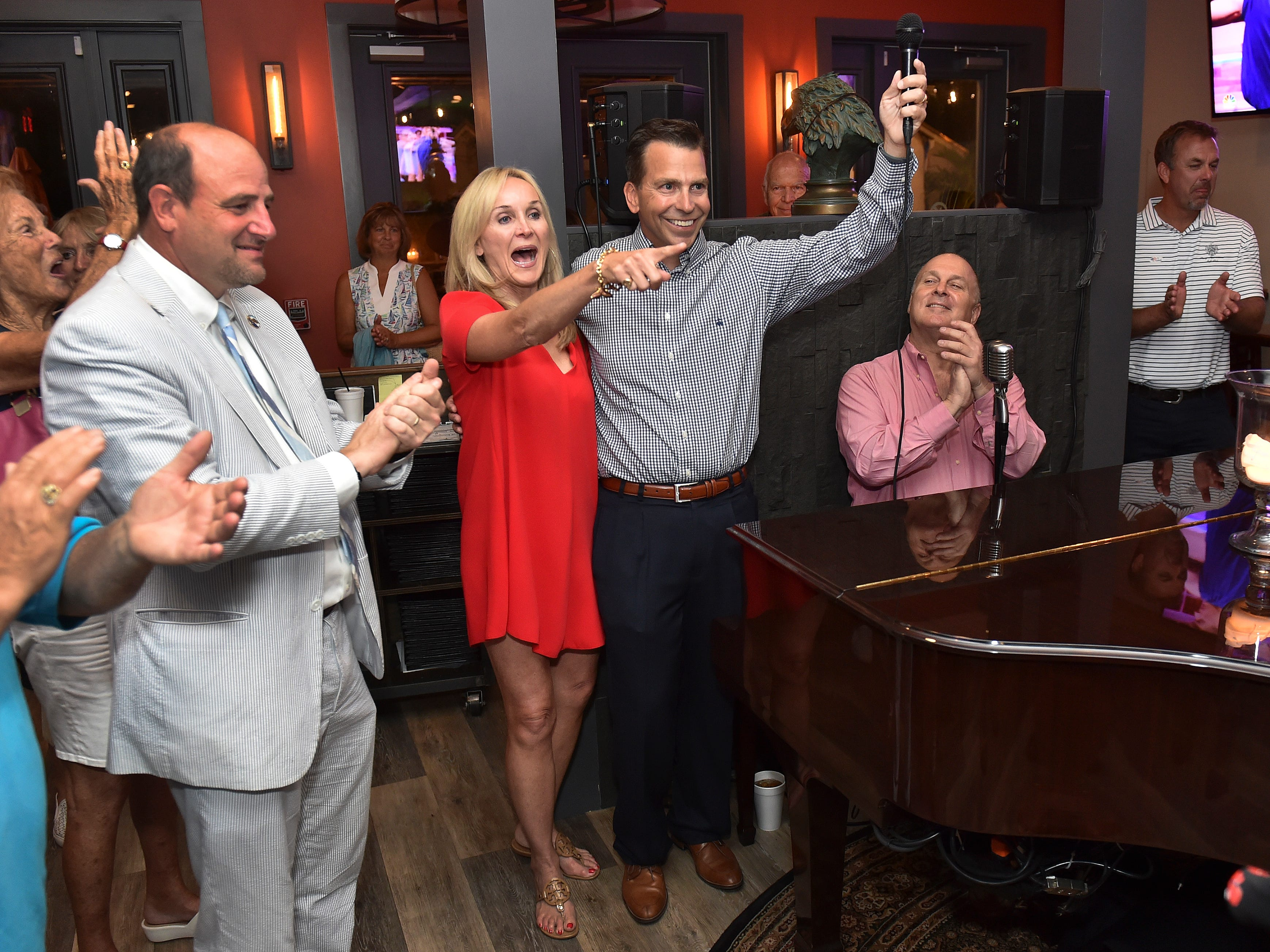 Toby Overdorf (center right) and his wife Maggie celebrates his win over Sasha Dadan in the Florida House District 83 Republican primary at the Talk House in Stuart on Tuesday, Aug. 28, 2018. Overdorf will face Democrat Matt Theobald, a Jensen Beach teacher, in the Nov. 6 general election for the two-year seat that represents parts of Martin and St. Lucie counties, currently held by Republican Rep. Gayle Harrell.