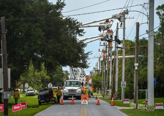 "FPL workers perform ""line hardening,"" replacing wooden power poles with cement structures, Wednesday, Aug. 29, 2018, along Fort Pierce Boulevard in the Lakewood Park neighborhood in Fort Pierce. Much of Lakewood Park was seriously flooded in the aftermath of Hurricane Irma in 2017."