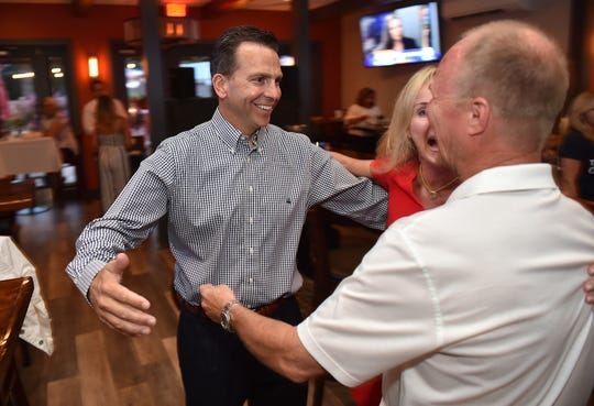 """Toby Overdorf (from left) and his wife Maggie are greeted by supporter John Leighton as they celebrate Overdorf's win over Sasha Dadan in the Florida House District 83 Republican primary at the Talk House Tuesday, Aug. 28, 2018, in Stuart. Overdorf will face Democrat Matt Theobald, a Jensen Beach teacher, in the Nov. 6 general election for the two-year seat that represents parts of Martin and St. Lucie counties, currently held by Republican Rep. Gayle Harrell. """"I'm so grateful for all the support that we have from our community, and from the folks that have come out right and left to help us and support us throughout Martin and St Lucie,"""" Toby Overdorf said. """"I'm really looking forward to the general (election).""""  To see more photos, go to TCPalm.com."""