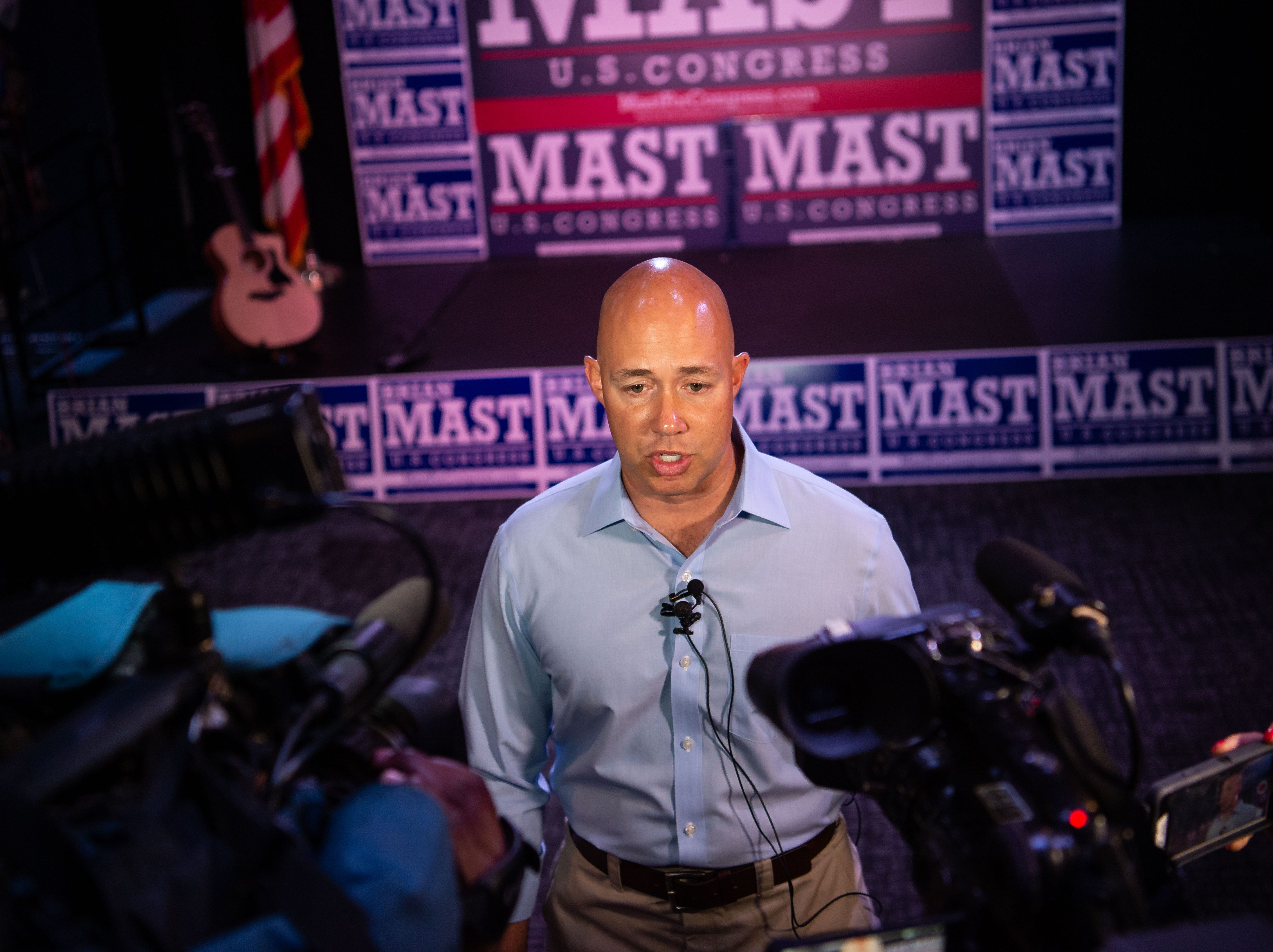 U.S. Rep. Brian Mast speaks with news media Tuesday, Aug. 28, 2018, at his primary election night party at Flagler Place in downtown Stuart, after the announcement of his securing the Republican Party's nomination to continue in his Dist.18 senate seat.