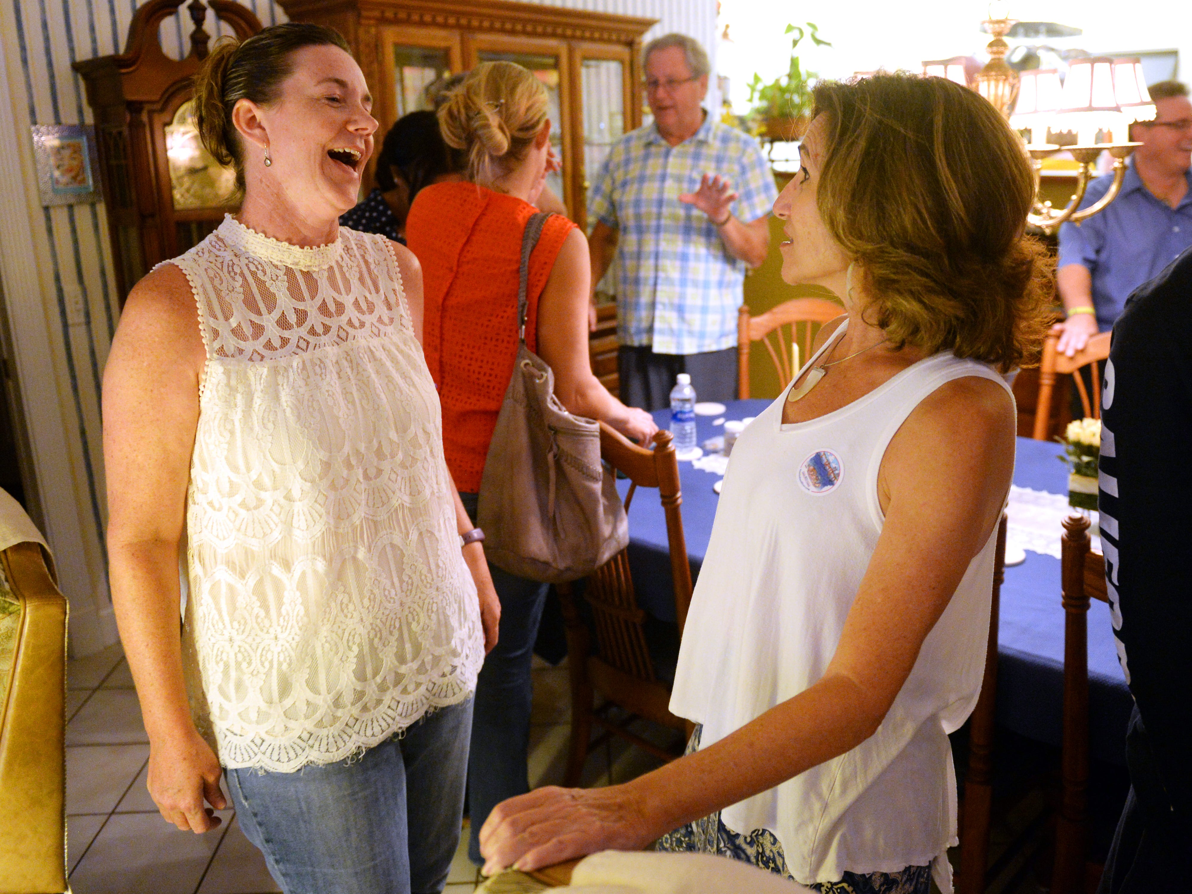 Indian River School Board candidates Mara Schiff and Stacey Klim attended an election watch party in Vero Beach, Tuesday, Aug. 28, 2018 as results are posted. Schiff won the District 1 seat over Eugene Wolff while Klim will face Teri Barenborg in a runoff in November.