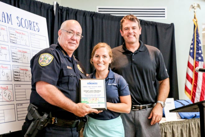 During 2017's Heroes Fore Freedom Golf Tournament, Port St. Lucie Chief of Police John Bolduc, left, handed out awards with Place of Hope's Jamie Bond and Founding Executive Director Charles L. Bender to golfers for their support in helping end human trafficking locally.