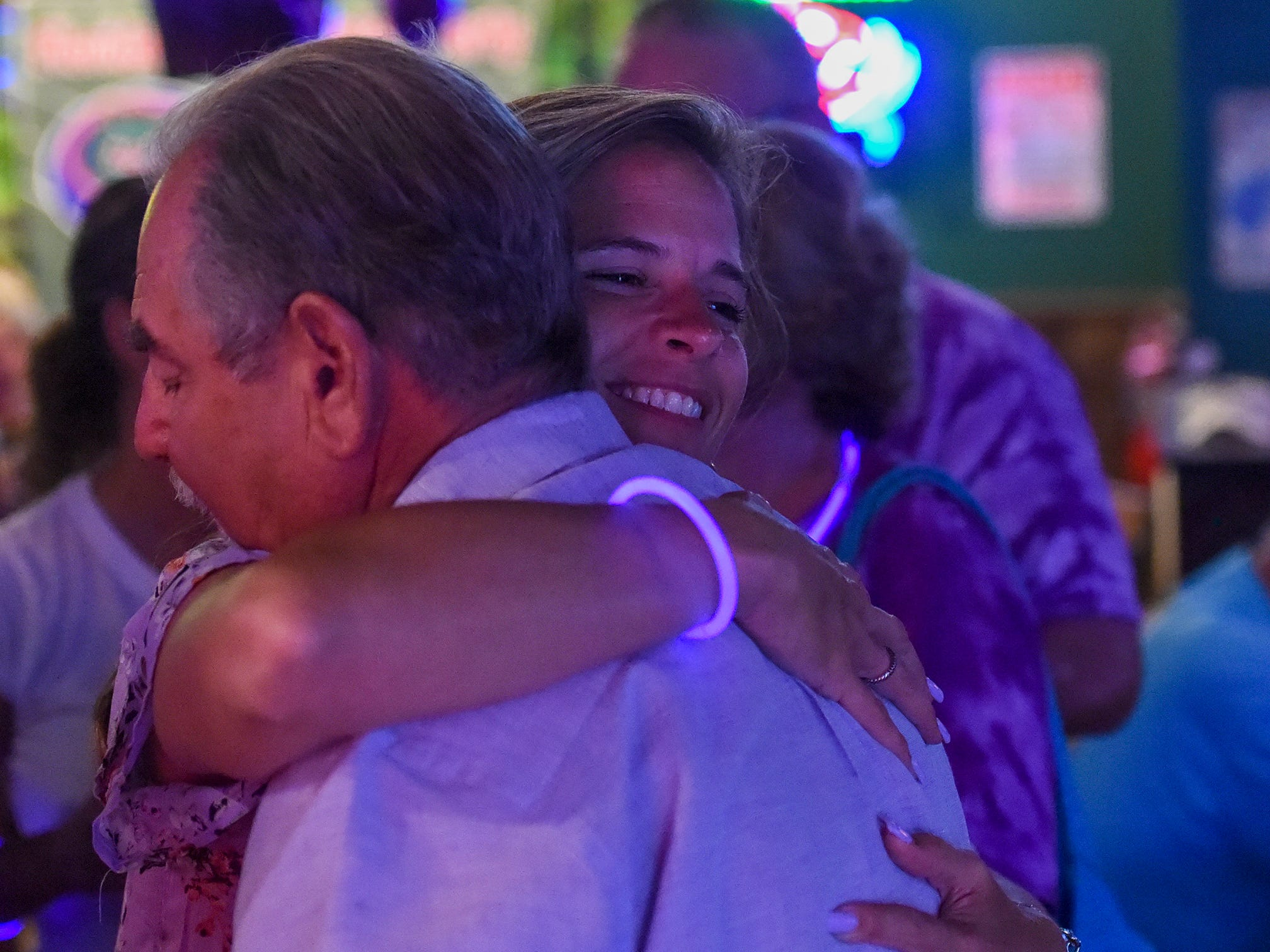 Martin County Commission District 4 candidate Niki Norton awaits election results Tuesday, Aug. 28, 2018, with friends, family, and supporters during her election night party at Charlie's Neighborhood Bar and Grill in Stuart.