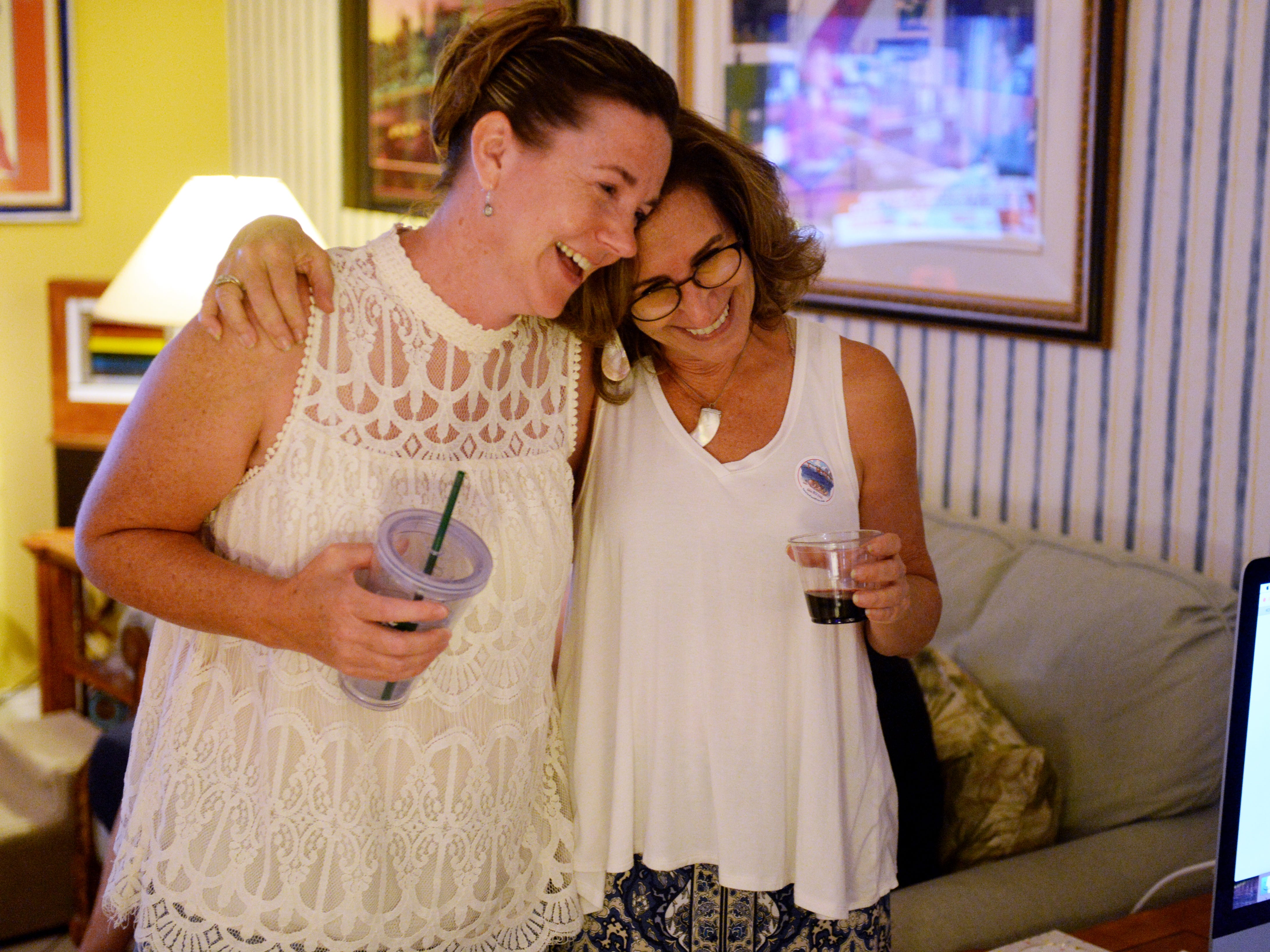 Indian River School Board District 4 candidate Stacey Klim (left) hugs School Board District 1 candidate Mara Schiff on Tuesday, Aug. 28, 2018 during an election party in Vero Beach. Klim will face Teri Barenborg in a runoff election in November. Schiff beat Eugene Wolff to claim the District 1 seat.