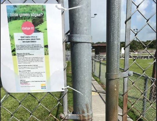 The Florida Department of Health in Martin County has installed signs warning of possibly toxic blue-green algae at the St. Lucie Lock and Dam.
