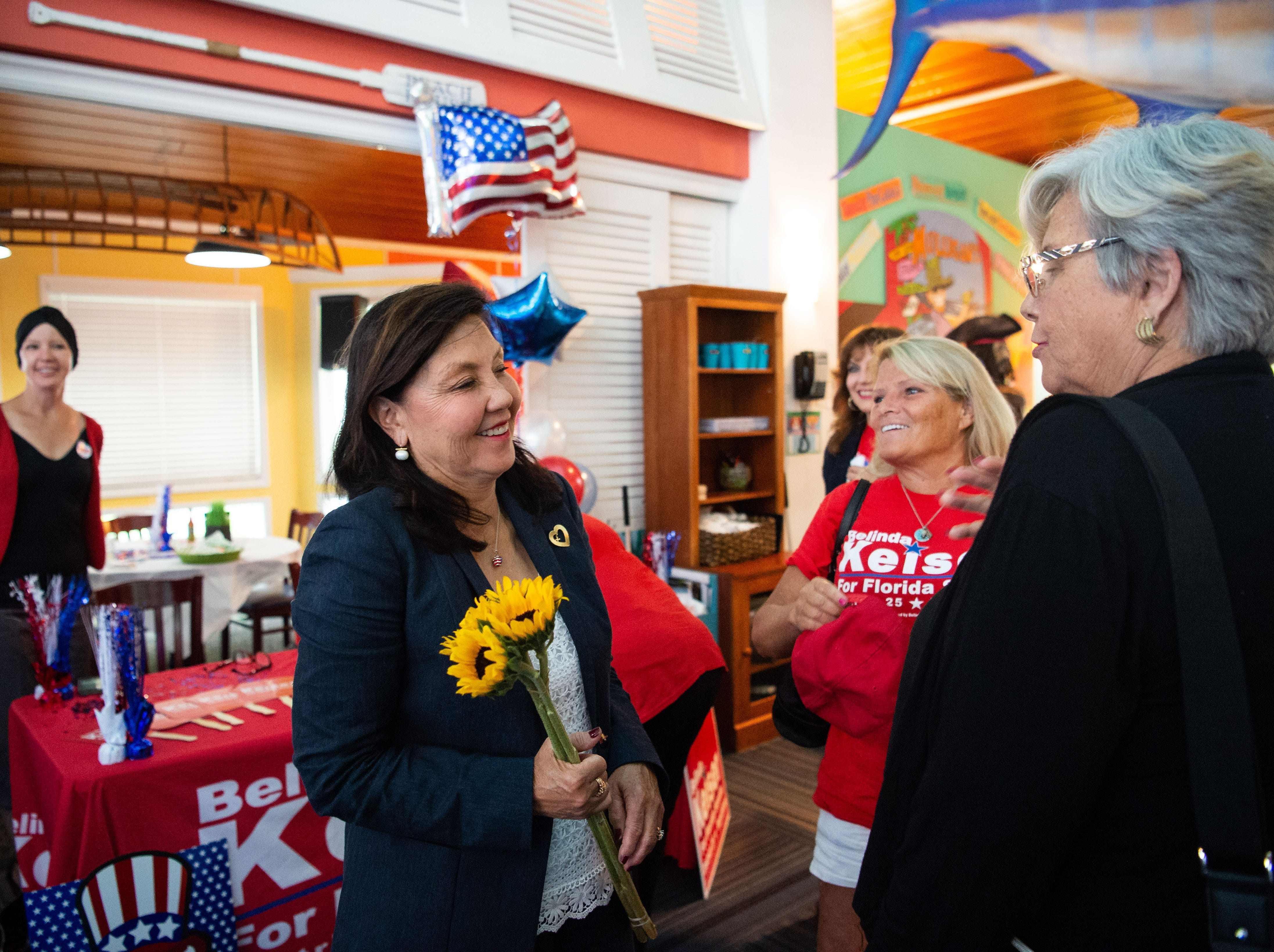 Keiser University administrator Belinda Keiser (left) speaks with campaign volunteer Ellen Williams (center), of Apollo Beach, and supporter Pegg Nott, of Palm City, at her primary election party Tuesday, Aug. 28, 2018, at Mulligan's Beach House Bar & Grill in downtown Stuart. Keiser lost her bid to State Rep. Gayle Harrell for the Senate Dist. 25 seat being vacated by Sen. Joe Negron.