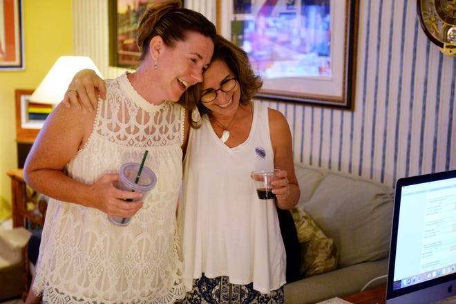 Indian River School Board District 4 candidate Stacey Klim (left) hugs School Board District 1 candidate Mara Schiff on Tuesday, Aug. 28, 2018, during an election party in Vero Beach. Klim will face Teri Barenborg in a runoff during the November election. Schiff beat Eugene Wolff to claim the District 1 seat.