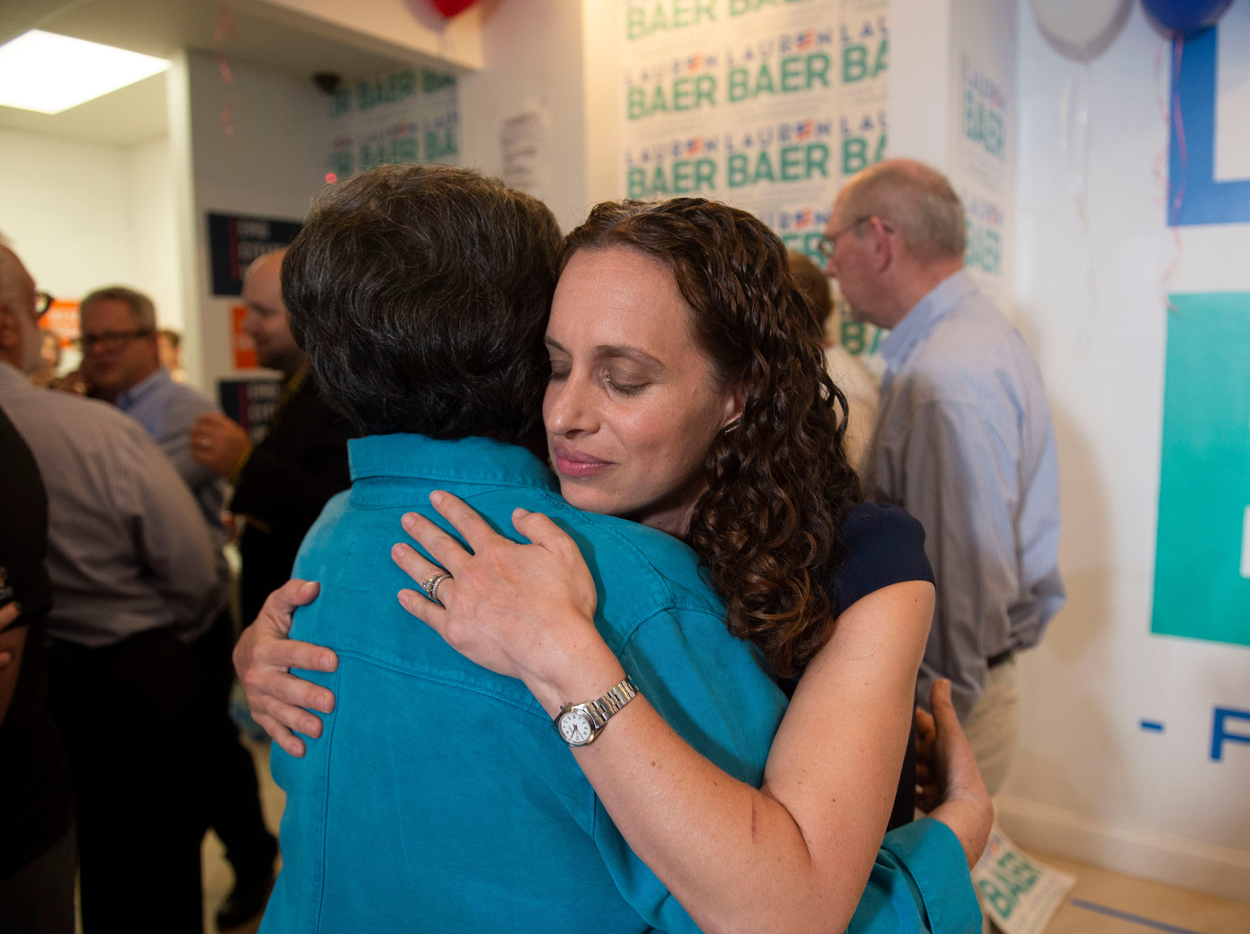 Democrat Lauren Baer, of Palm Beach Gardens, is congratulated by U.S. Rep. Lois Frankel on Baer's U.S. House District 18 win against Pam Keith in the primary election on Tuesday, Aug. 28, 2018 at her campaign office in Jupiter. Baer, a former Obama administration foreign policy advisor, will be facing incumbent U.S. Rep. Brian Mast in the Nov. 6 general election.