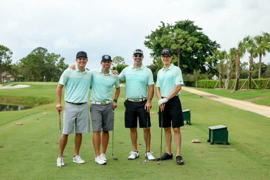 Kevin Wilson, left, Seth Ray, Travis O'Neal and Andy Glass play in the 2017 Heroes Fore Freedom Golf Tournament.