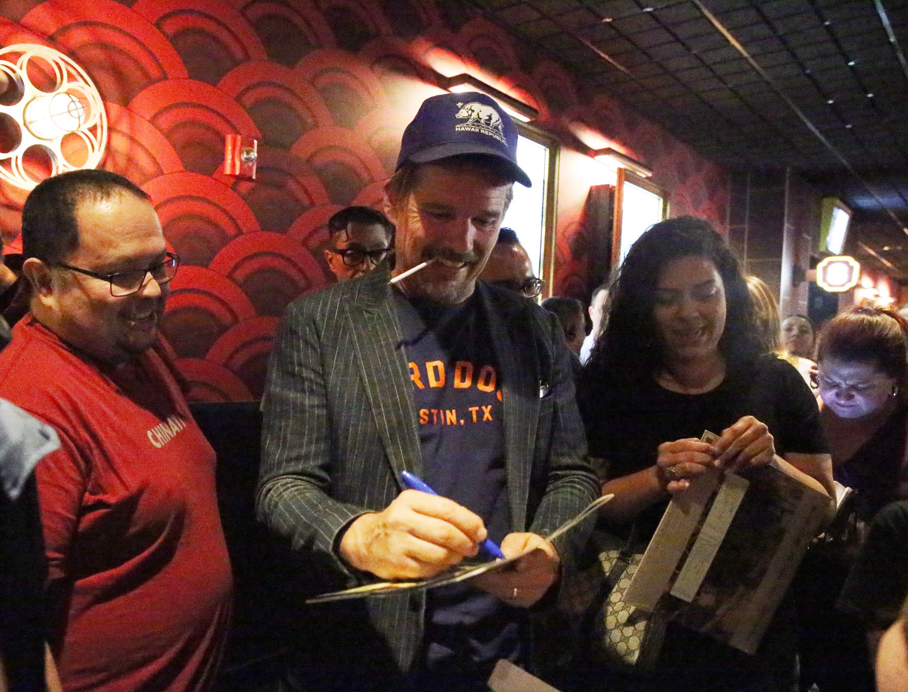 Movie fans get autographs from actor and director Ethan Hawke, center, following the screening of the movie 'Blaze' Tuesday night at Alamo Drafthouse in West El Paso. Hawke directed the movie, based on the life of country Texas musician Blaze Foley.