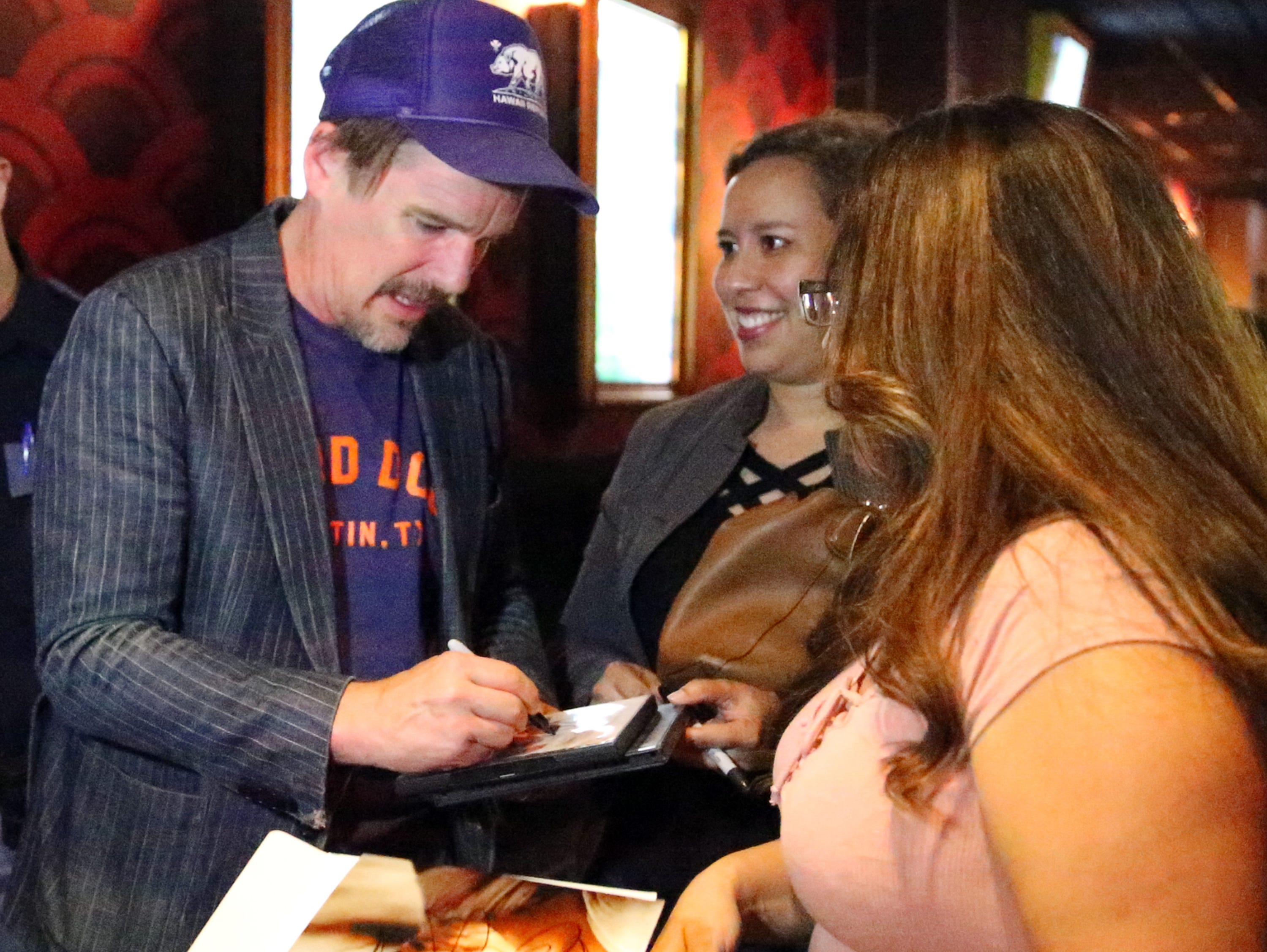 "Actor and director Ethan Hawke signs autographs for fans who watched a screening of the movie ""Blaze"" on Tuesday at the Alamo Drafthouse Cinema-Montecillo in West El Paso. Hawke directed the movie."