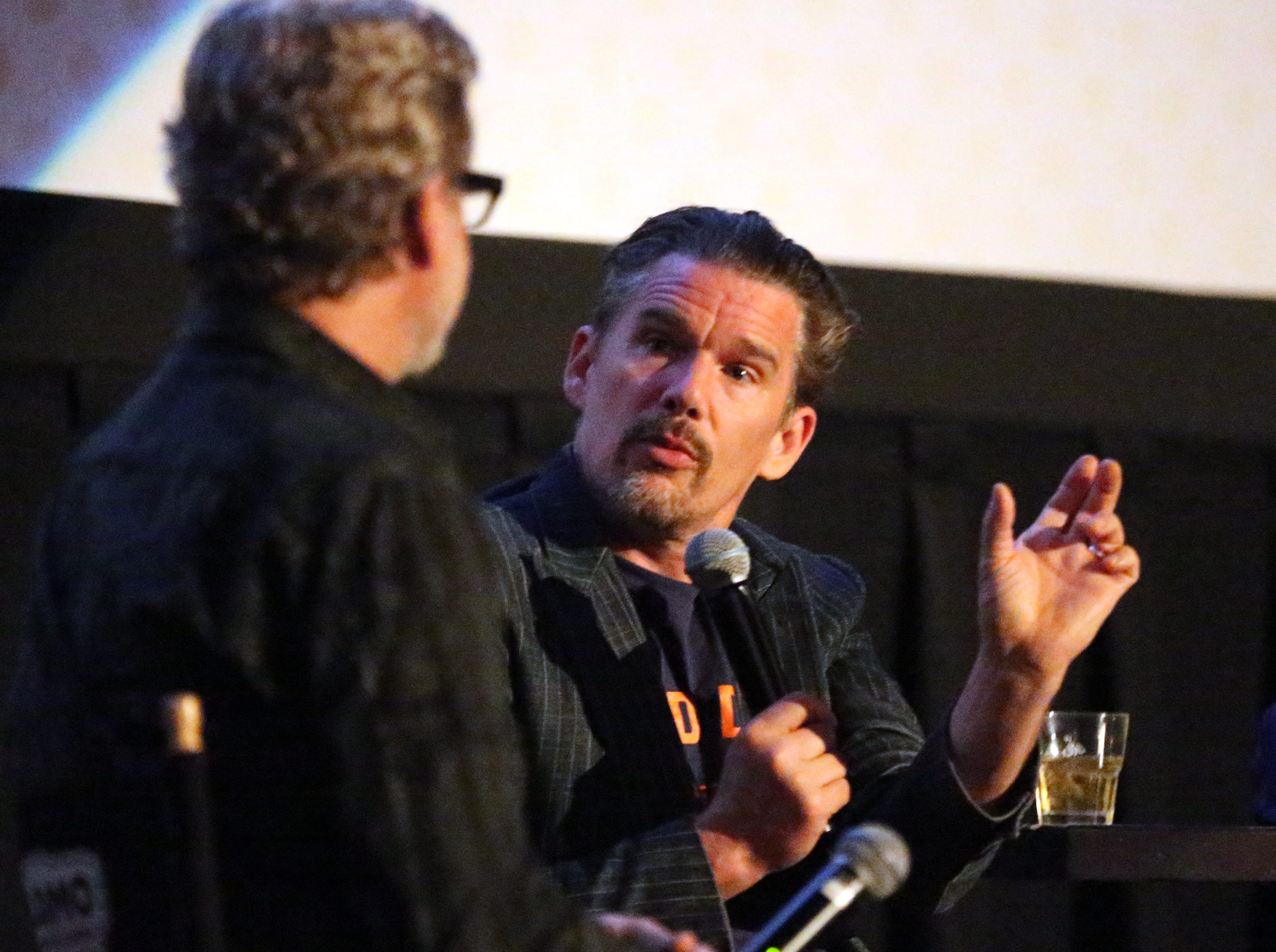 Actor and director Ethan Hawke, right, talks with guest interviewer Charles Horak following the screening of the movie 'Blaze' on Tuesday night at Alamo Drafthouse Cinema-Montecillo. Hawke directed the movie, starring his longtime friend Ben Dickey.