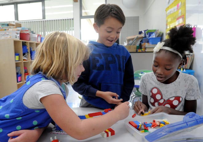 From left, Addison Ghaffary, William Ananta, and Jaida Coats work together on building a bridge at Knolls School in Simi Valley. The school just got flexible seating in classrooms this year. The flexible seating allows teachers to get students more engaged with learning material and working together in groups.