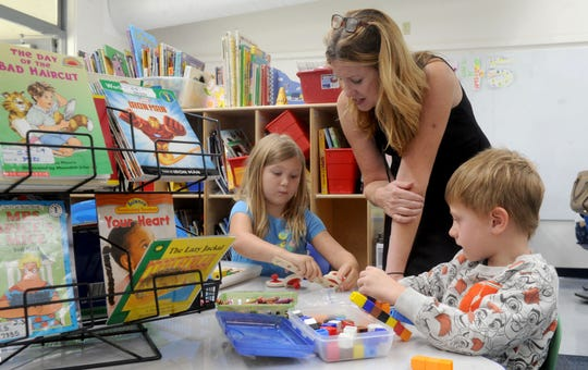 From left, Brooklyn Styles, her teacher Angela Dellacort-Thomas and Kodiak Caldara work together on their building projects at Knolls School in Simi Valley. The school has adopted a project-based learning system.