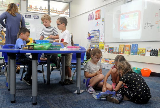 Kindergartners and first-grade students work on their building projects at Knolls School in Simi Valley. The school is investing in flexible seating to help with collaborative learning.