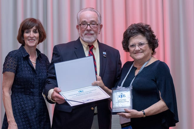 Jan Meisels Allen, right, accepts the Outstanding Publications Award from the International Association of Jewish Genealogical Societies at its conference in Warsaw from President Ken Bravo and Awards Committee Chair Karen Franklin. The award is for Venturing into Our Past, the electronic newsletter of the Jewish Genealogical Society of the Conejo Valley and Ventura County. Allan Linderman (not shown) is the editor, and Jan Allen is president of the Jewish Genealogical Society of the Conejo Valley and Ventura County.