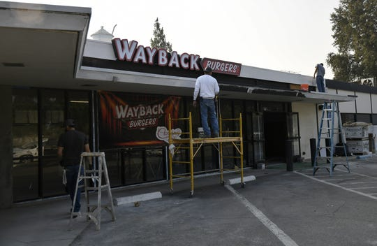 Crews work on restaurant Wayback Burgers located on Tulare Avenue on Thursday, August 9, 2018.
