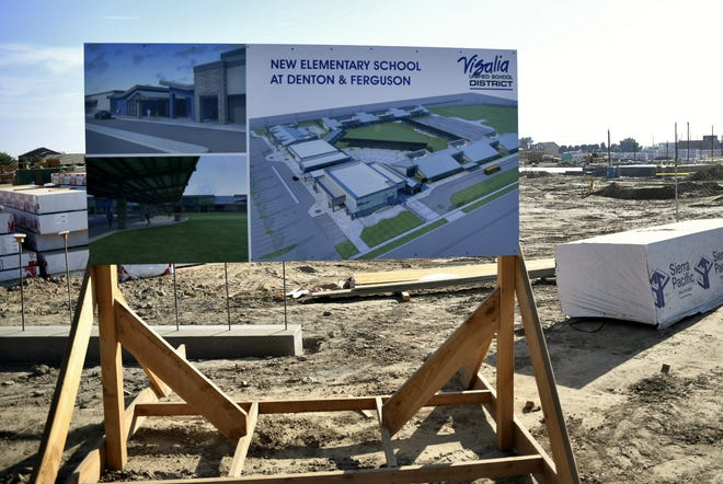A rendering of Visalia Unified's newest elementary school sits at the corner of Denton Street and Ferguson Avenue on Tuesday, August 28, 2018.