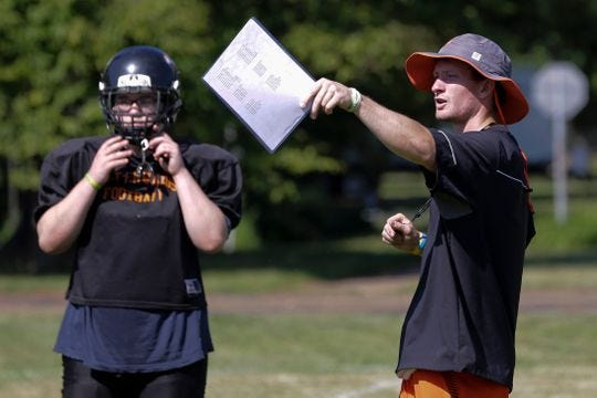 Port Edwards football coach Max Ayres gives direction to his team during a recent practice. The Blackhawks are in their first year as a WIAA 8-player program after operating as an independent in 2017 after canceling their 11-player schedule.