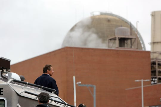 Tania Savayan/The Journal News Gov. Andrew Cuomo surveys an oil spill at Indian Point in Buchanan. Gov. Andrew Cuomo surveys the oil spill at Indian Point in Buchanan on Sunday.