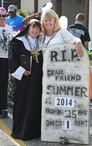 """Sister"" Marie Wright (left) and ""Angel"" Carolyn Bacon at the Bethany Beach Jazz Funeral in 2014."