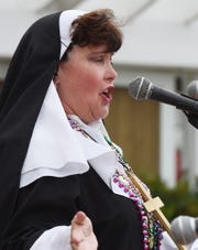 """Sister"" Marie Wright speaks at a past Bethany Beach Jazz Funeral."