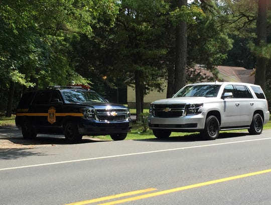 Police vehicles in front of the home at Harbeson where Delaware State Police shot Robert Knox on Tuesday morning, Aug. 28, 2018.