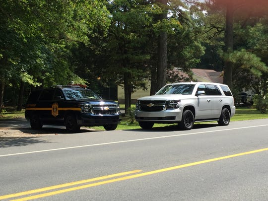 Police vehicles in front of the home at Harbeson where Delaware State Police shot Robert Knox on Tuesday morning, Aug. 28.