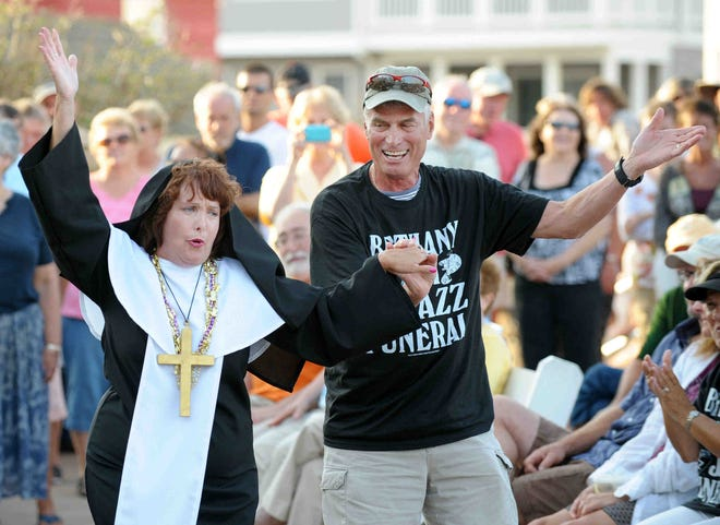 """Sister"" Marie Wright dances with a member of the crowd at the Bethany Beach Jazz Funeral in 2011."