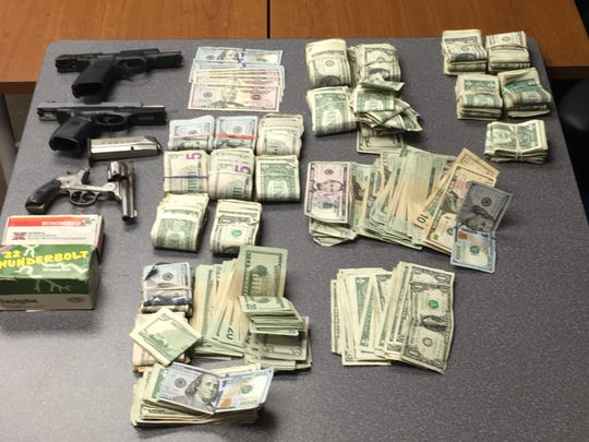 Guns and money found at the Harbeson house where a 50-year-old paraplegic was shot by state police during a raid.