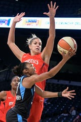 Washington Mystics guard Elena Delle Donne defends Atlanta Dream guard Renee Montgomery during the first half of Game 2 of a WNBA semifinals basketball playoff Tuesday, Aug. 28, 2018, in Atlanta. Delle Donne went down with a knee injury late in the game.