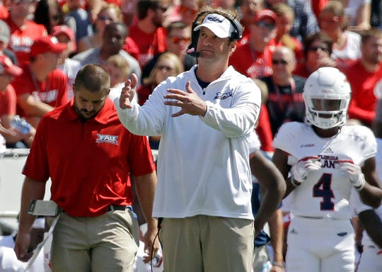 FILE - In this Sept. 9, 2017, file photo, Florida Atlantic head coach Lane Kiffin gestures from the sidelines during an NCAA college football game against Wisconsin in Madison, Wis. Kiffin orchestrated a remarkable turnaround at Florida Atlantic last season and then didn't get hired away by any bigger programs. (AP Photo/Aaron Gash, File)