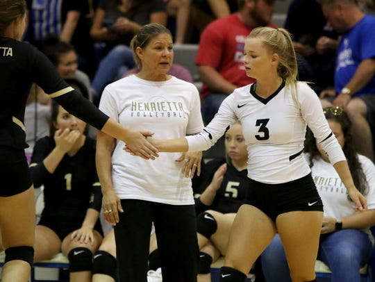 Henrietta's Chelsea Burns switches with Kynlea Stewart in the match against Windthorst Tuesday, Aug. 28, 2018, at Windthorst.