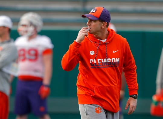 File-This Dec. 30, 2017, file photo shows Clemson head coach Dabo Swinney running practice for the upcoming Sugar Bowl NCAA semifinal playoff game against Alabama in New Orleans. Swinney's Tigers are the heavy favorite to become the first ACC team to win four straight league titles since Florida State's dominating run through the 1990s. (AP Photo/Gerald Herbert, File)