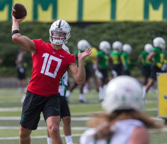 Oregon NCAA college football quarterback Justin Herbert (10) throws during the start of fall camp at the Hatfield-Dowlin Complex in Eugene, Ore. Friday, Aug. 3, 2018. (Brian Davies/The Register-Guard via AP)