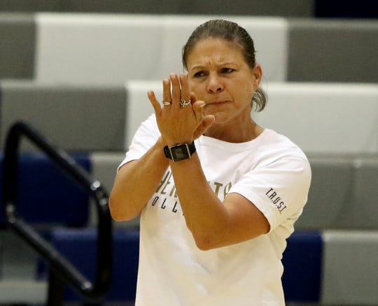 Henrietta head volleyball coach Rochelle Kabisch claps for her team in the match against Windthorst Tuesday, Aug. 28, 2018, at Windthorst.
