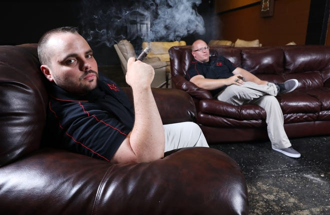Will Callahan, left, and Josh Binkley, co-owners of the Travelling Humidor, a cigar bar on Third Street in Zanesville, will host a benefit block party on Saturday, September 8th.