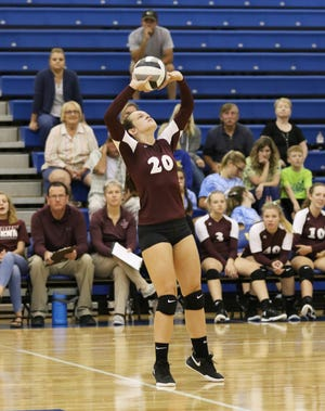 John Glenn's Abby Dickson sets the ball against West Muskingum in this file photo. Dickson led the MVLin assists per set (8.33, 583 total assists) to go with 96% serving last year.