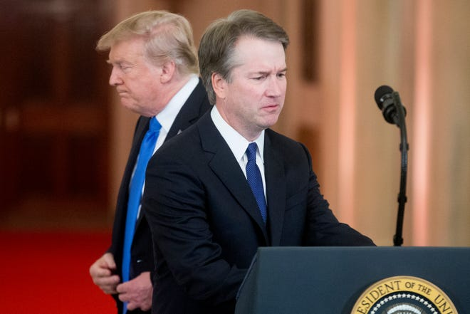 President Donald Trump, here with federal appeals court Judge Brett Kavanaugh after announcing his nomination to the Supreme Court, has shadowed the confirmation process ever since.