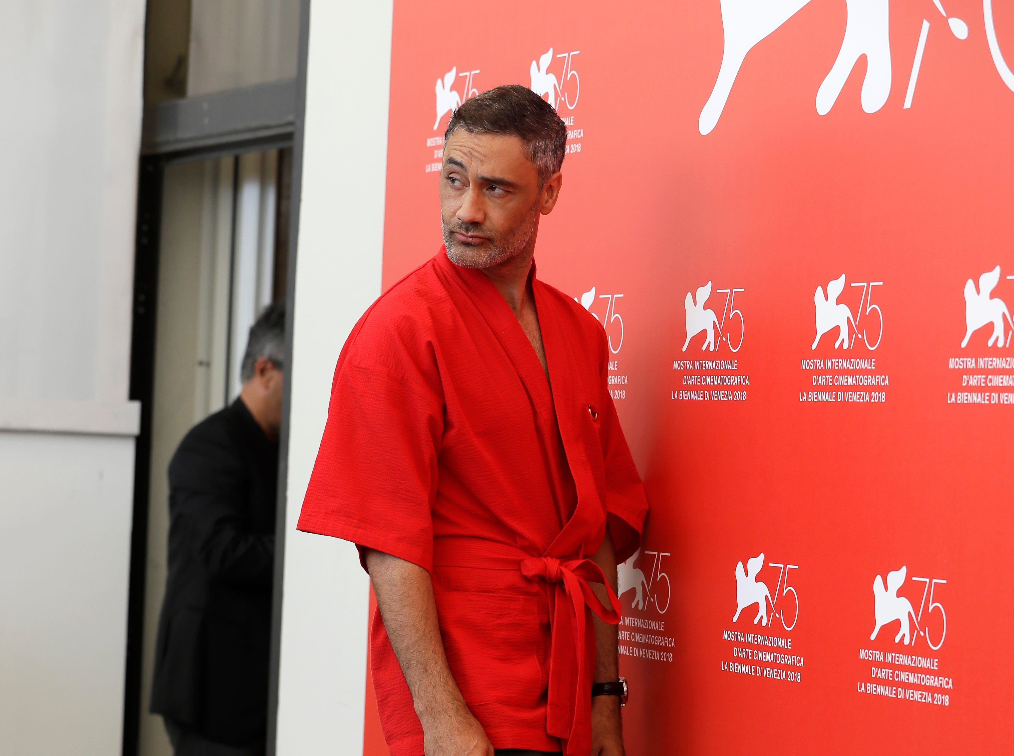 Jury member Taika Waititi poses for photographers at the photo call for the Jury at the 75th edition of the Venice Film Festival in Venice, Wednesday, Aug. 29, 2018. (AP Photo/Kirsty Wigglesworth)