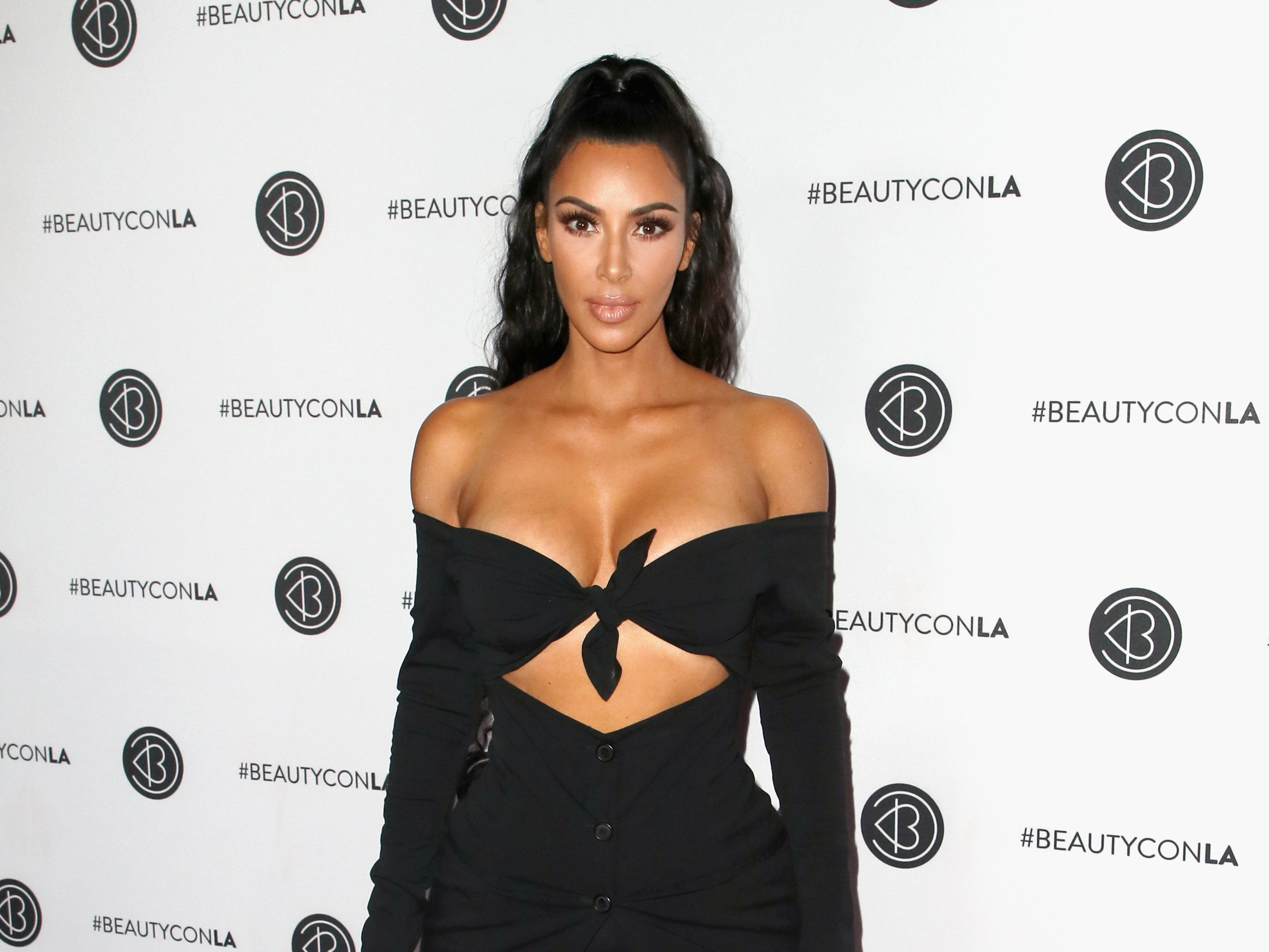 Kim Kardashian West wore a tie-up ensemble at the Beautycon Festival on July 15, 2018 in Los Angeles.