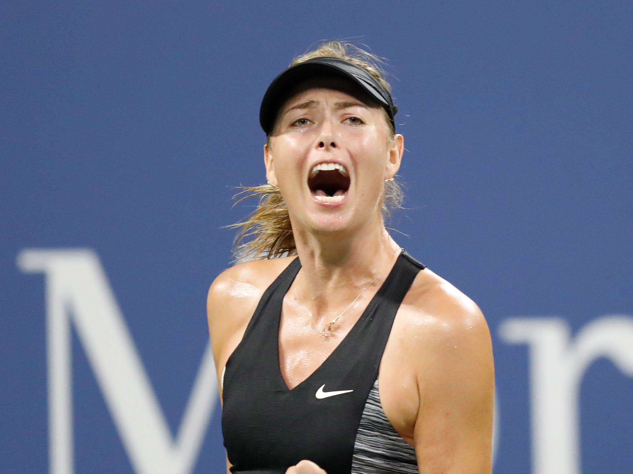Maria Sharapova of Russia celebrates during her first-round victory against Patty Schnyder of Switzerland.