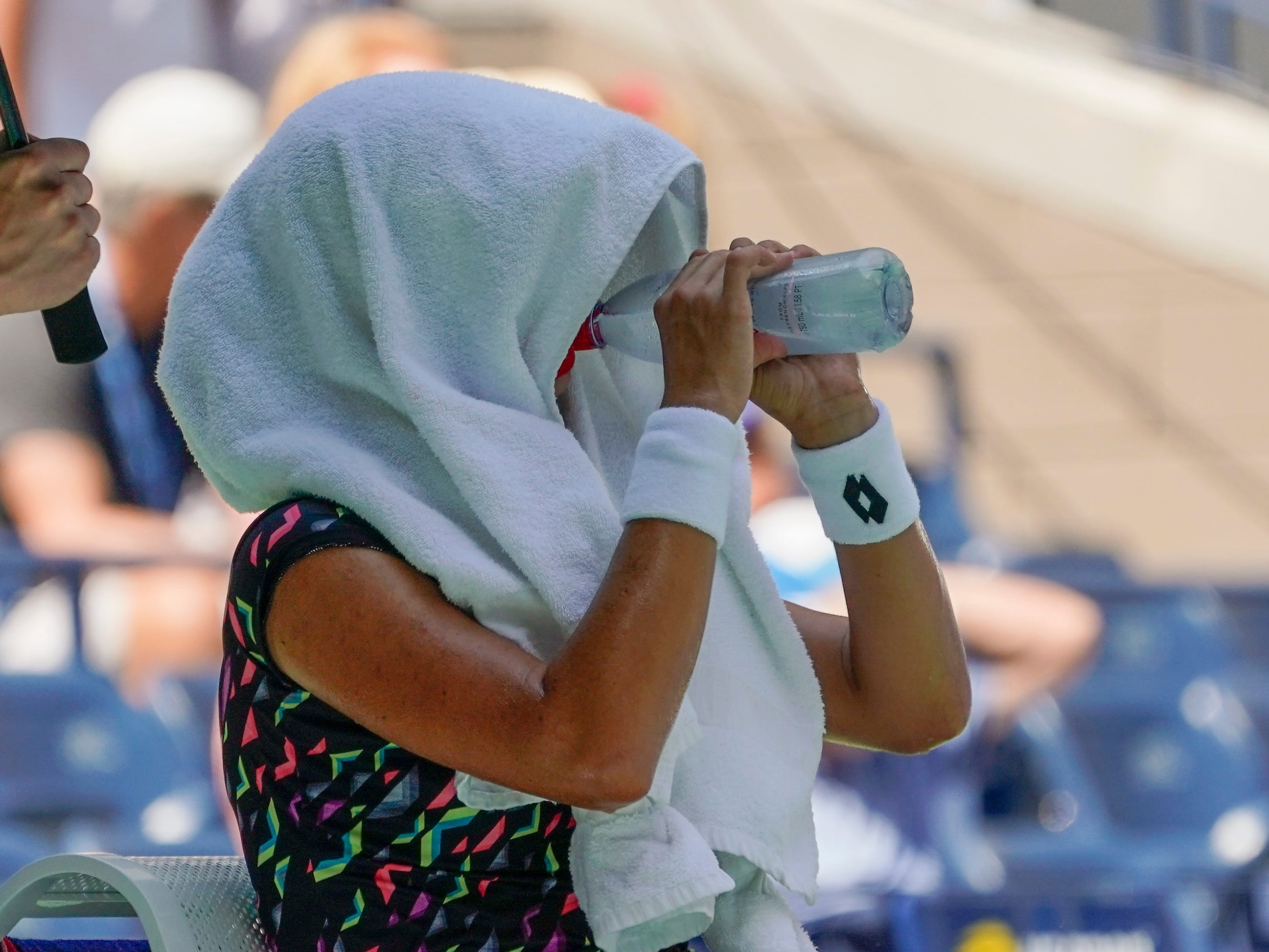 Anhelina Kalinina of Ukraine copes with the extreme heat while playing Sloane Stephens of the USA in a second-round match.