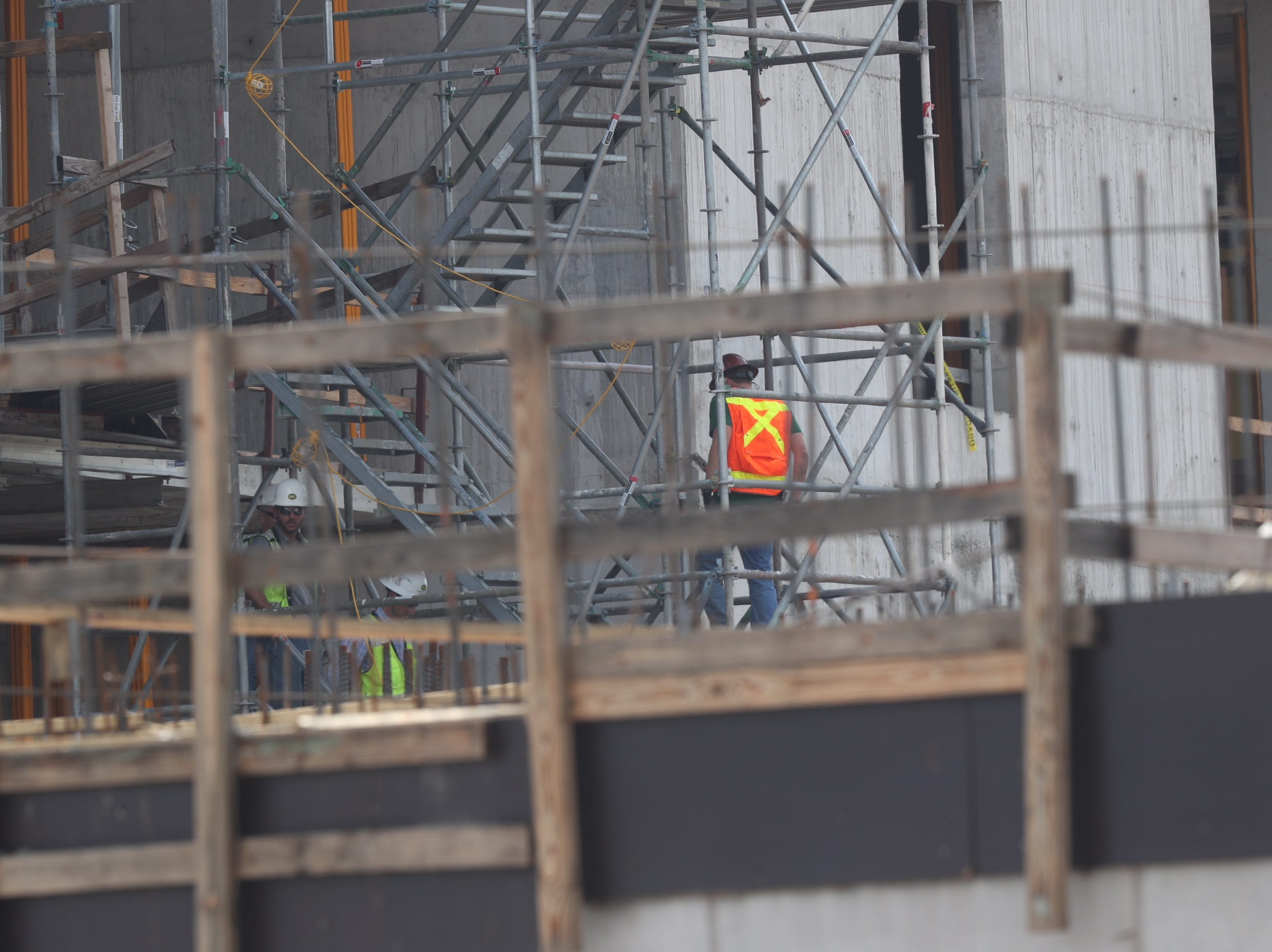 Two workers were killed early Wednesday morning after scaffolding collapsed falling seven stories to their deaths.