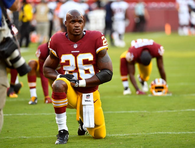 Washington Redskins running back Adrian Peterson (26) on the field before the game between the between the Washington Redskins and the Denver Broncos at FedEx Field.