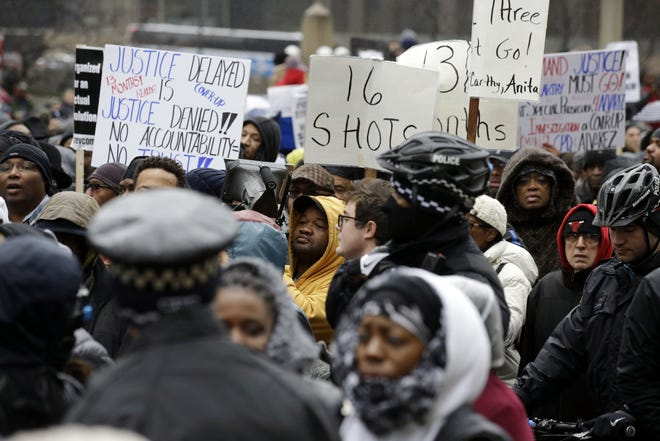 """In this Nov. 27, 2015, file photo, protesters take part in a """"march for justice"""" in Chicago, in the wake of the release of video showing an officer fatally shooting Laquan McDonald."""