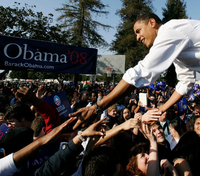 Then-Democratic presidential hopeful Barack Obama reaches to shake the hands of supporters after his first campaign rally in Los Angeles, on Feb. 20, 2007. A street near the rally site is being named for Obama.