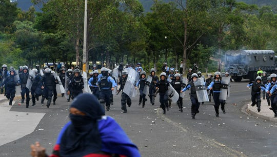 Honduran National Police clash with students of the National Autonomous University of Honduras who block Suyapa Boulevard as they protest the hike in the price of urban transportation and taxi fares in Tegucigalpa, Honduras, on August 1, 2018.