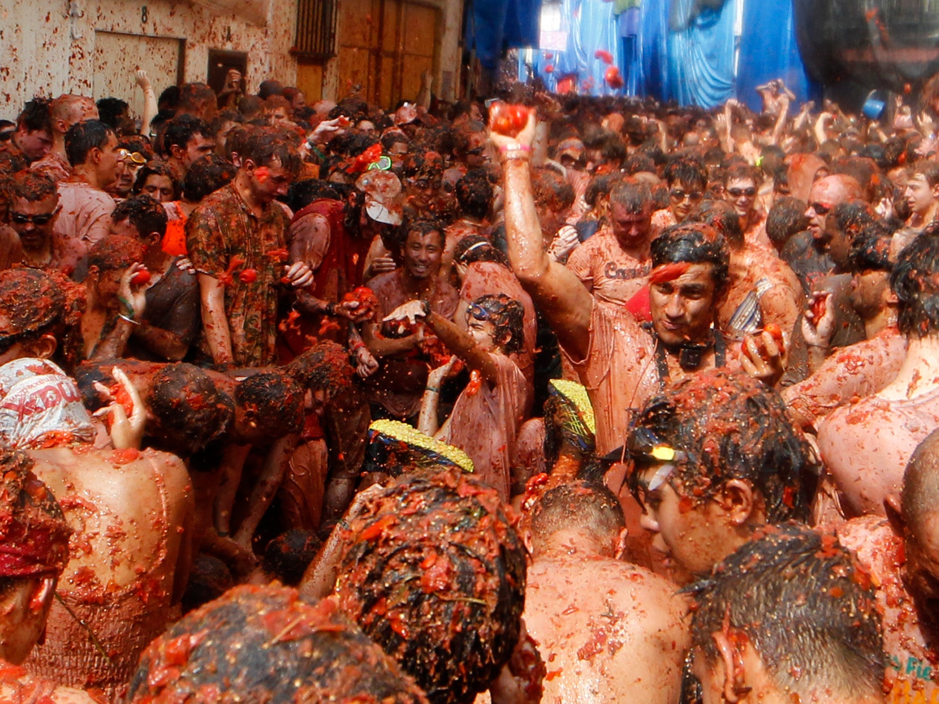 Revelers throw tomatoes at each other, during the annual Tomatina, tomato fight fiesta, in Bunol, Spain,  Aug. 29, 2018.
